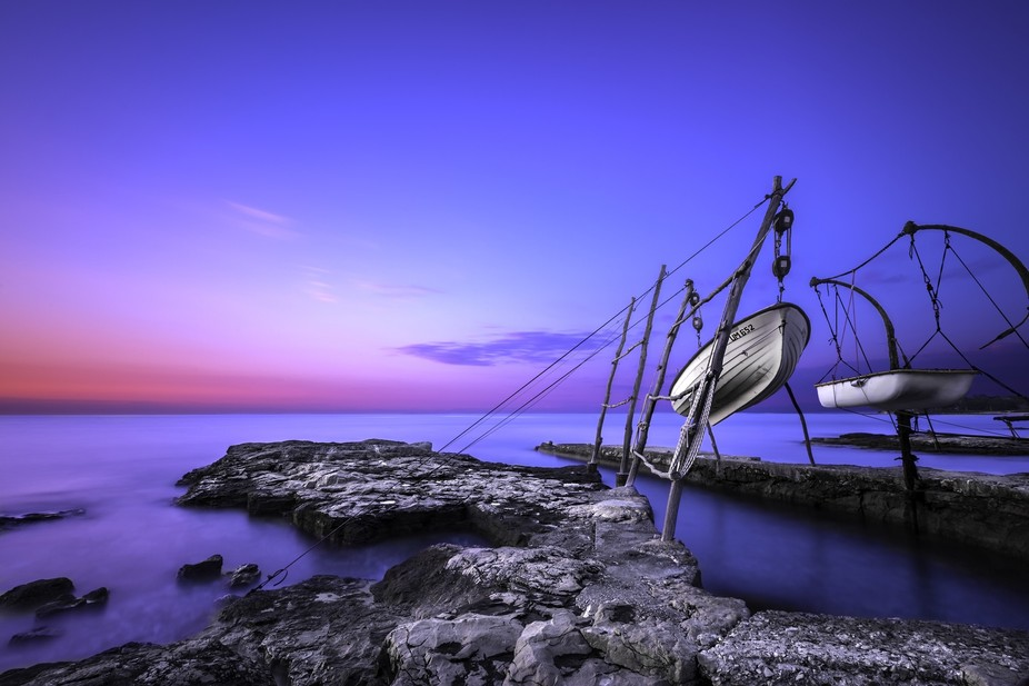 This is a sunset photo of hanging boats in Savudrija, Istria, the most northern part of the Croat...