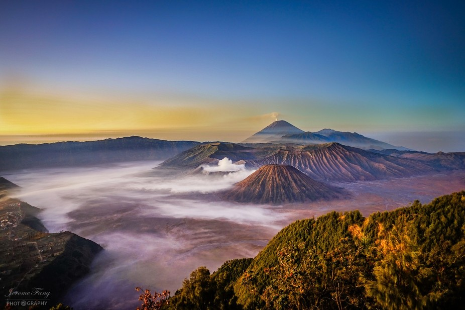 A beautiful and Foggy Sunrise of Mount Batok, Mount Bromo and Mount Semeru, taken from the viewpo...
