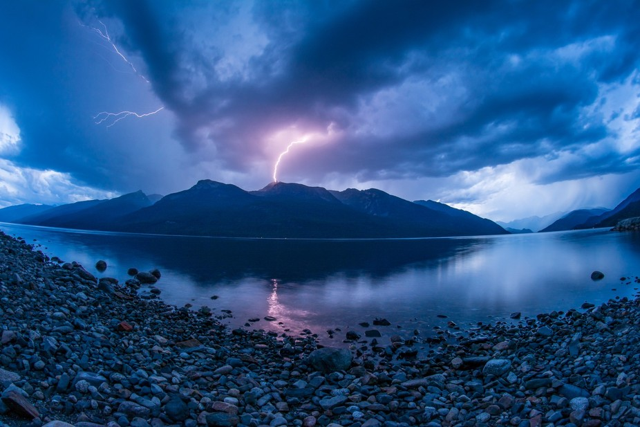 This bolt actually started a forest fire but was put out within 10 min by the heavy rains and hai...