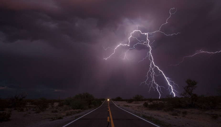 After playing chicken with the cars on this busy Arizona highway, a lightning bolt finally cooper...
