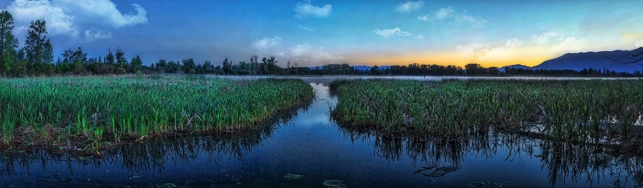 4 shot stitched panorama of dawn at a favorite fishing hole in Montana.