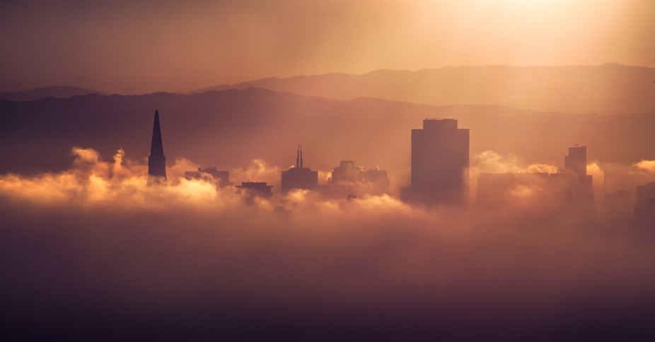 San Francisco layered in Fog during this mornings sunrise. This was a few minutes after the sun c...