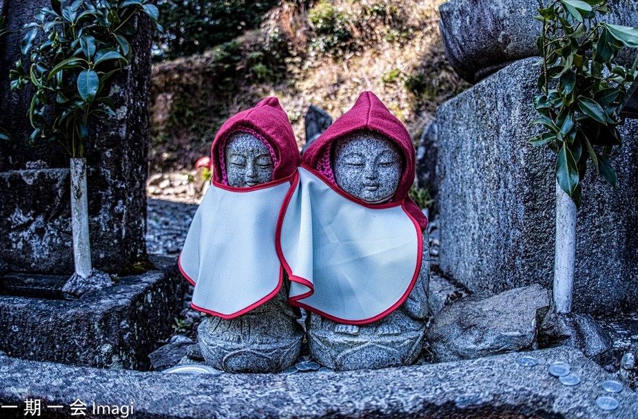 Dressed up jiso statues at a temple in Shikoku Japan.