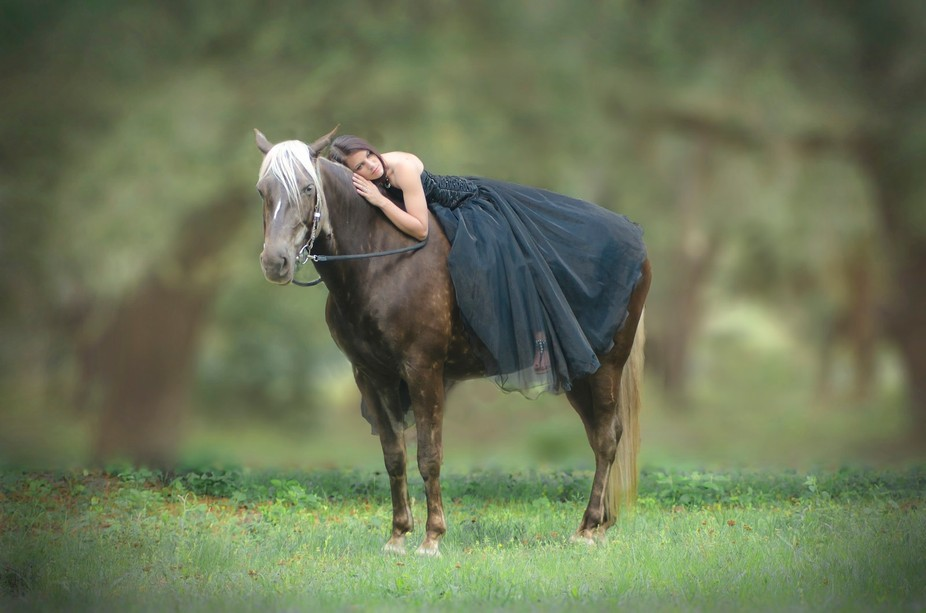 A girl who loves her horse.