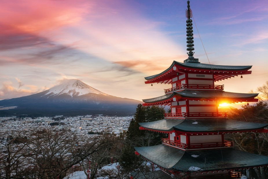 Sunset at the famous five storied Chureito Pagoda on the mountainside overlooking Mount Fuji.   S...
