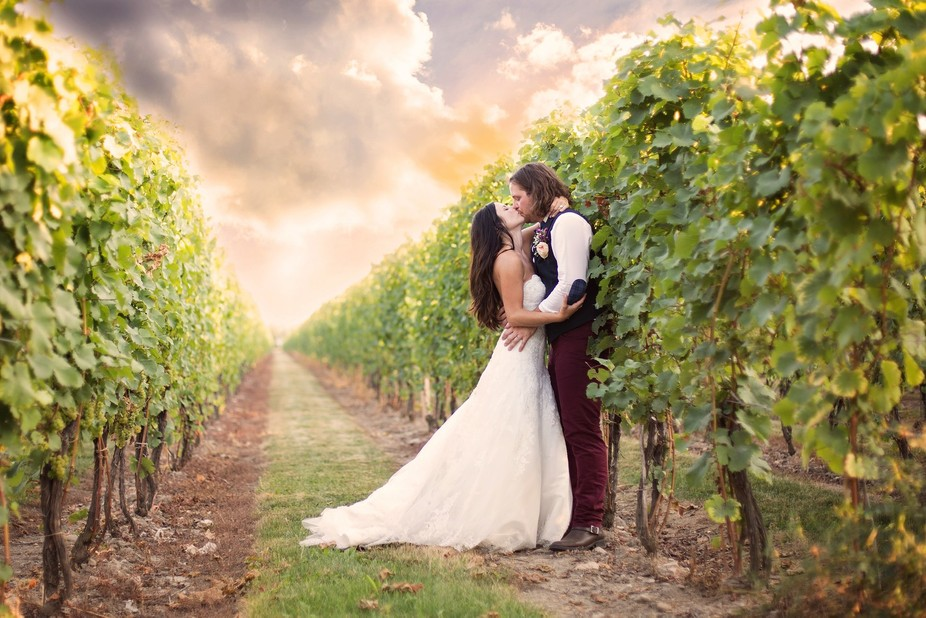 During dinner, the couple and I had the chance to sneak off to the nearby vineyard to grab some m...