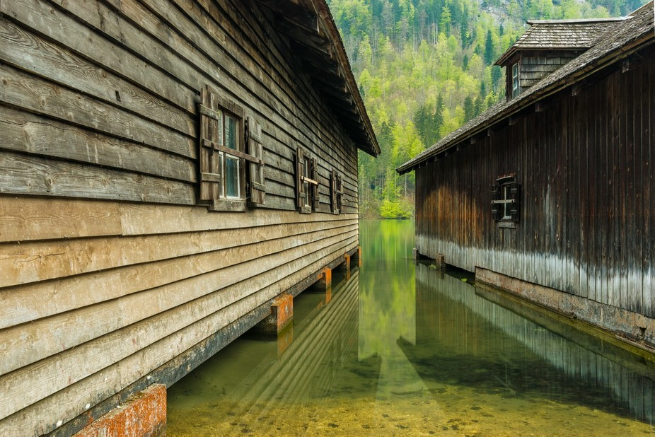 Boat houses at lake Koenigssee in the Alps of Bavaria, Germany https://de-de.facebook.com/Martin....