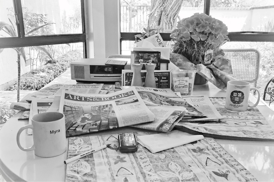 Faded shared moment of Sunday morning reading the newspapers over coffee, B/W