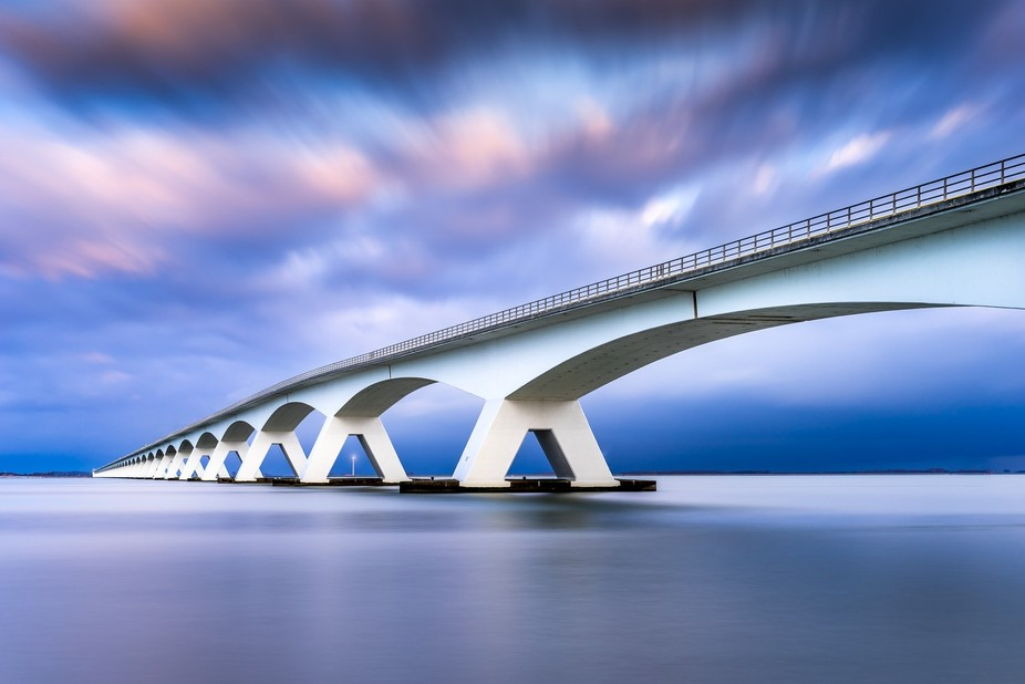 This is a picture I took of the Zeeland Bridge, which is the longest bridge in the Netherland. It...