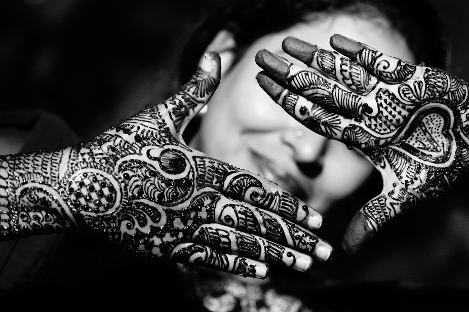 Mehendi shot of Indian bride this was straight out of the camera unedited. Light source : street ...