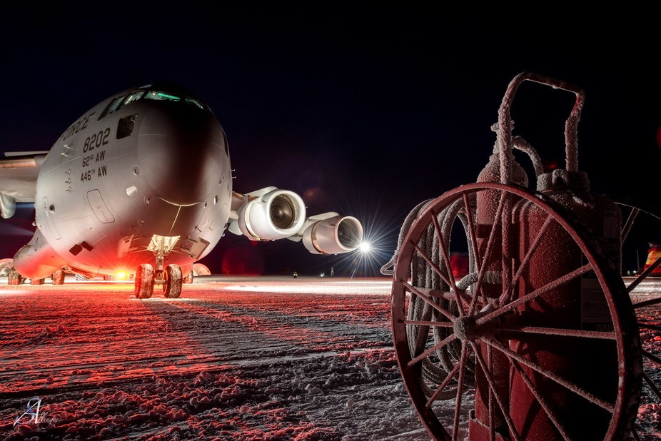 A C-17 Globmaster giving an air of dominating presence over the apron. A lonely Fire bottle, the ...