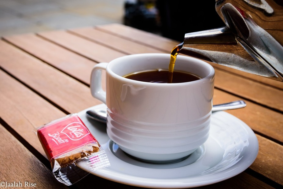 Pouring a cup of tea in London, England.