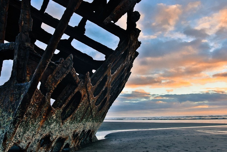 Photo of the decaying Peter Iredale that ran ashore nearly 110 years ago. Notice the trail leadin...