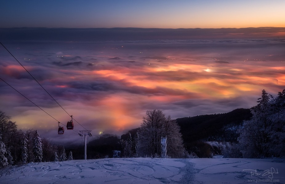 First snow on the Pohorje hill, overlooking Maribor in the morning fog