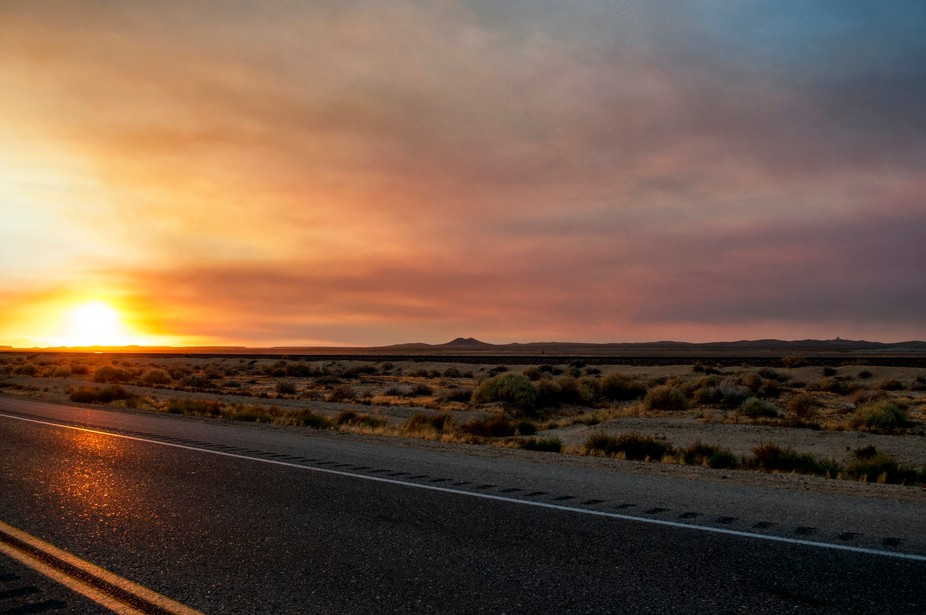 This sunset was capture in the Mojave desert as a sandstorm was blowing off in the distance.