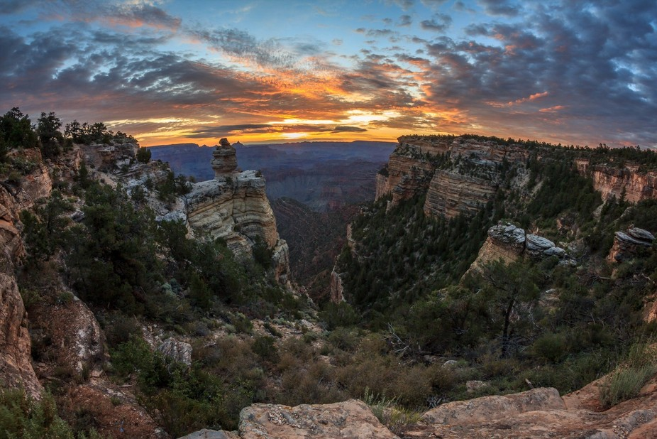 A few seconds before sunrise, the view was simply breathtaking from the top of the canyon, so man...