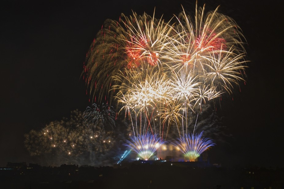 Fireworks show at new years, Edinburgh Castle from Inverleith Park.