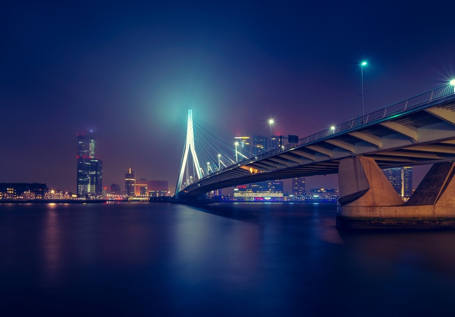 The awesome city of Rotterdam at night. Love the mixture of the different lights! The foggy condi...