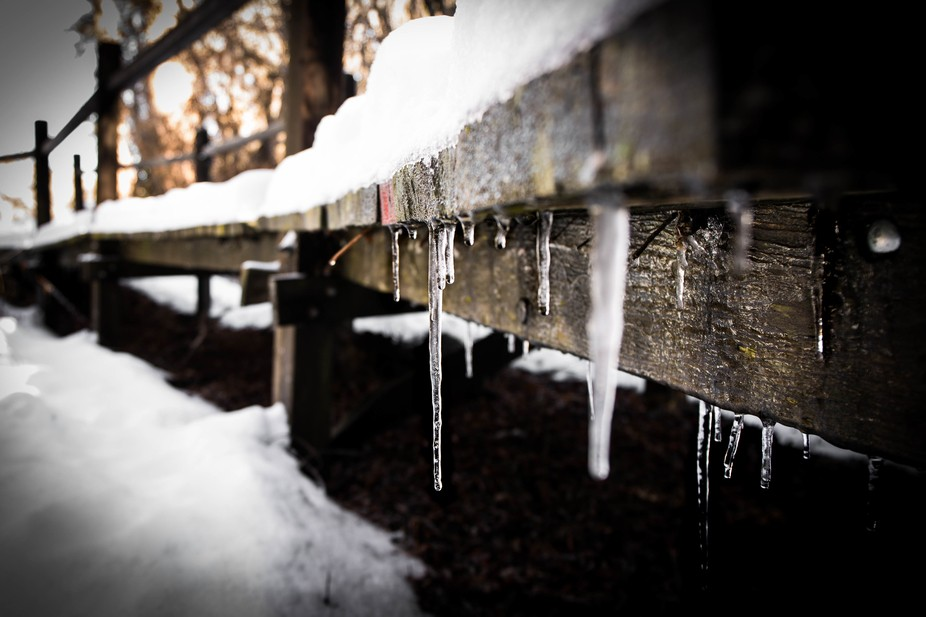I spotted these beautiful icicles under a snow covered foot bridge in the mountains of California.