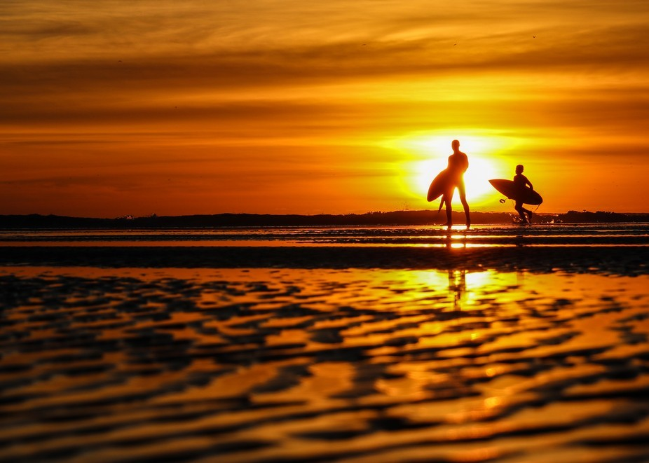 This is an amazing photo of a dad and his boy coming in from a stealer day in the sun. this day m...