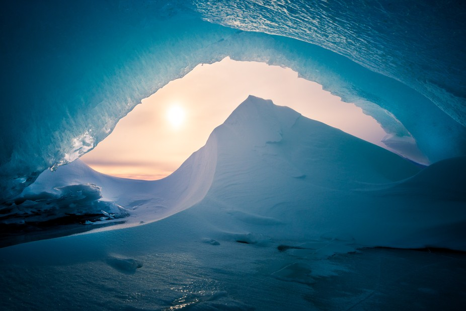 Found a small ice cave on a lake.  Looked inside and found this beautiful scene where the drifted...