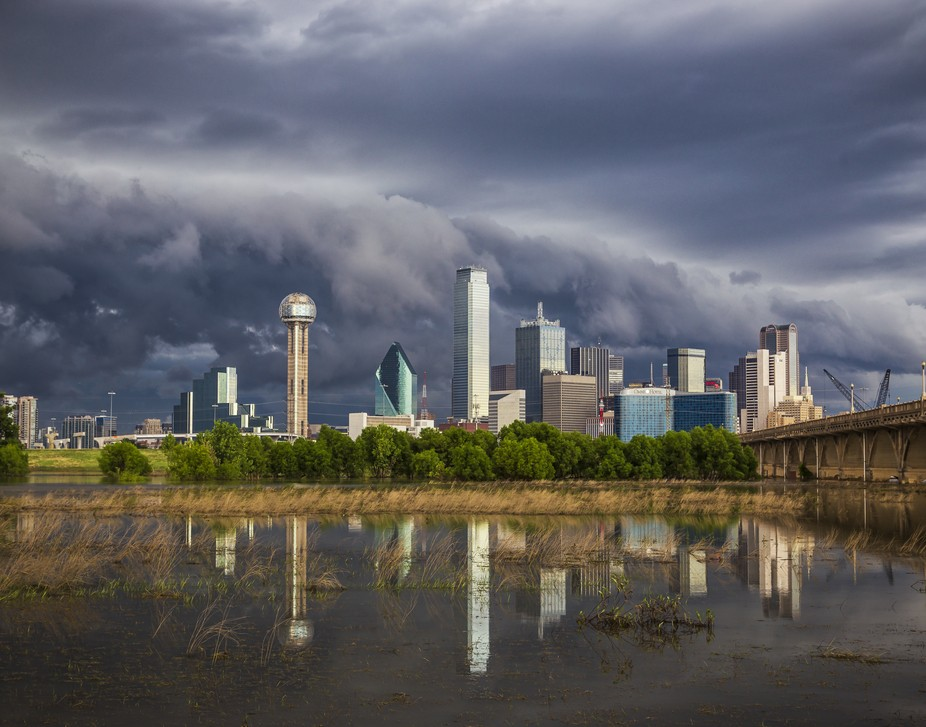 A low hanging shelf cloud pushes over the Dallas Skyline ahead of a major summer thunderstorm.  C...