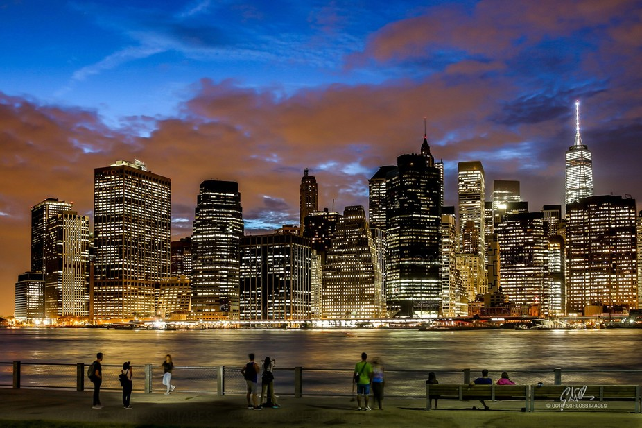 People from all walks of life, gather at the Brooklyn riverfront to enjoy the scenic view of Lowe...