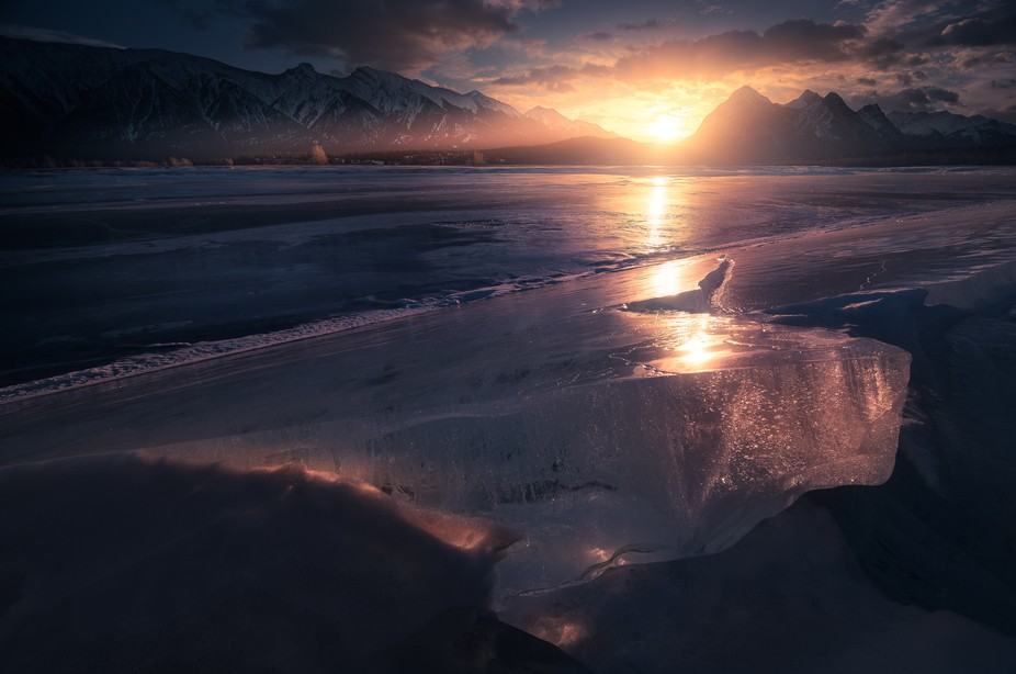 While exploring Abraham Lake for ice bubbles, I noticed the sun illuminating parts of the ice as ...