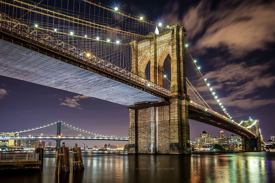 A twilight view of the Brooklyn, Manhattan and Williamsburg bridges from the perspective of the S...