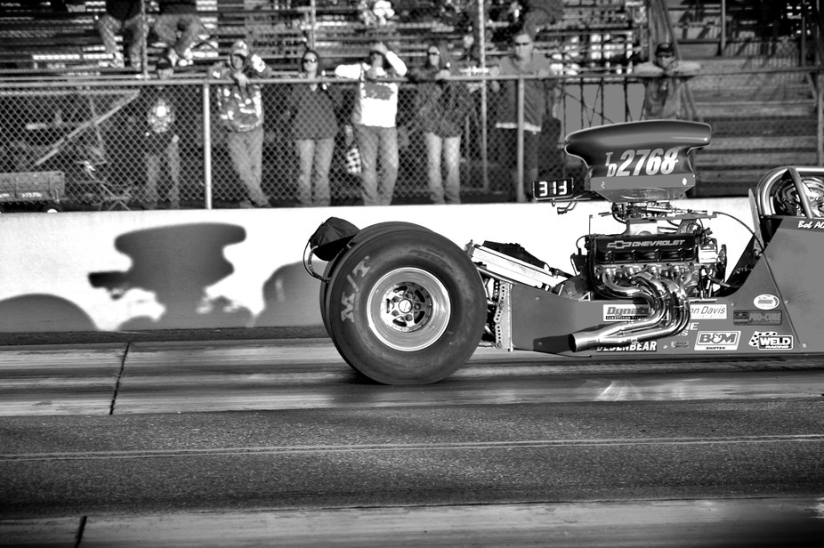 Quarter mile dragster with tires gripping.