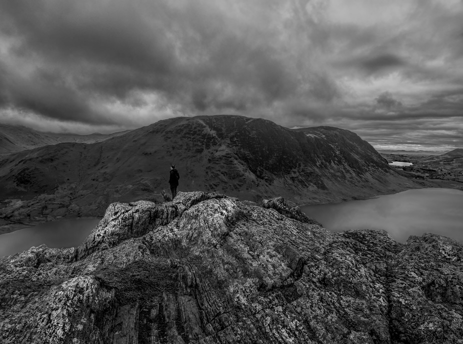 The summit of Rannerdale Knots looking over Crummock water in the English Lake District with my d...