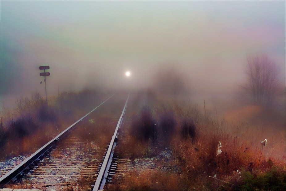 A foggy morning by the train tracks .....