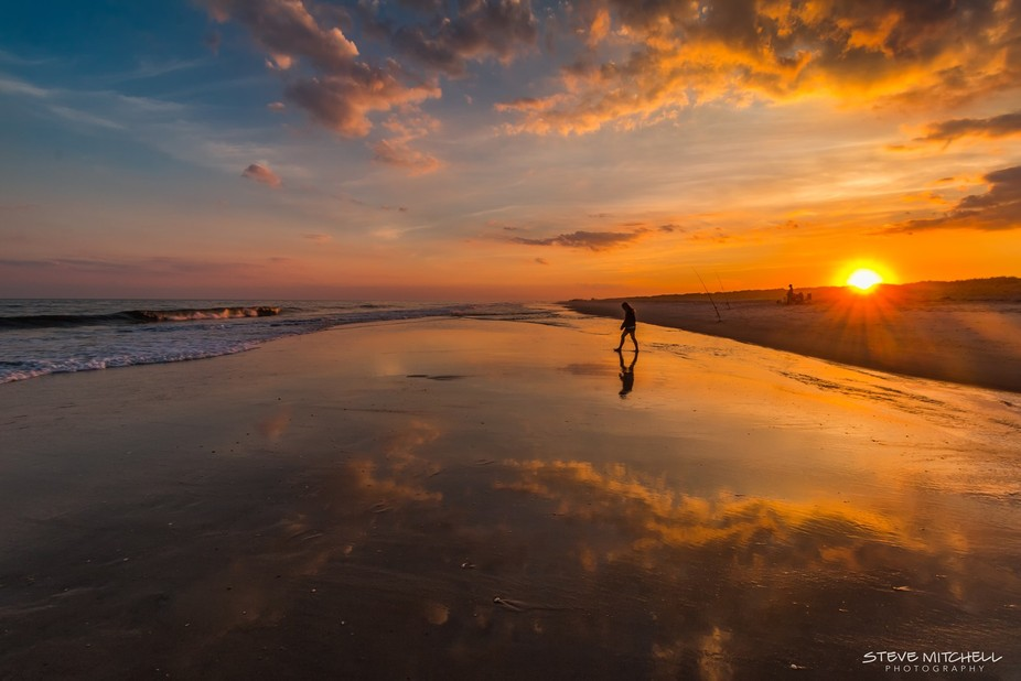 My daughter Sarah walking on the beach during a beautiful and reflecting sunset at Robert Moses B...