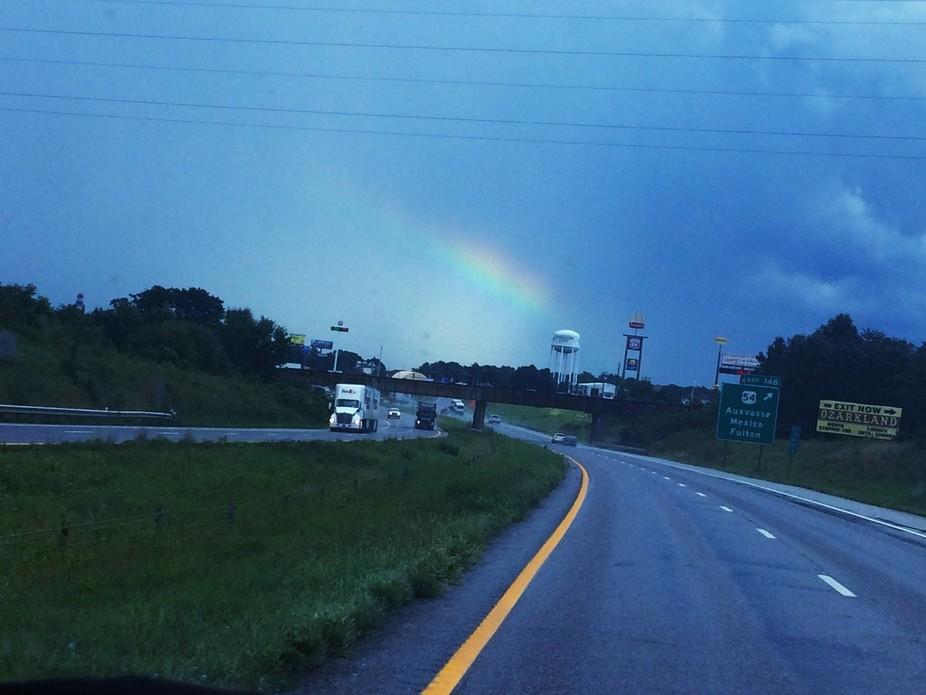 A rainbow after a passing storm while driving on the highway. I love seeing them and remembering ...