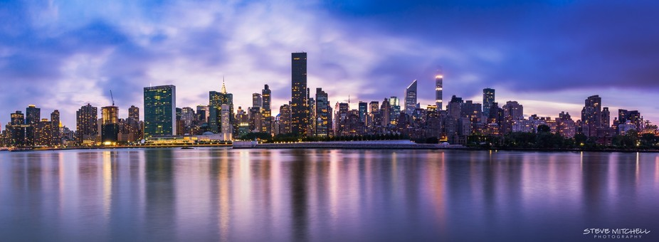 Low clouds and the end of a colorful sunset set over the Manhattan Skyline. Shot from Gantry Plaz...