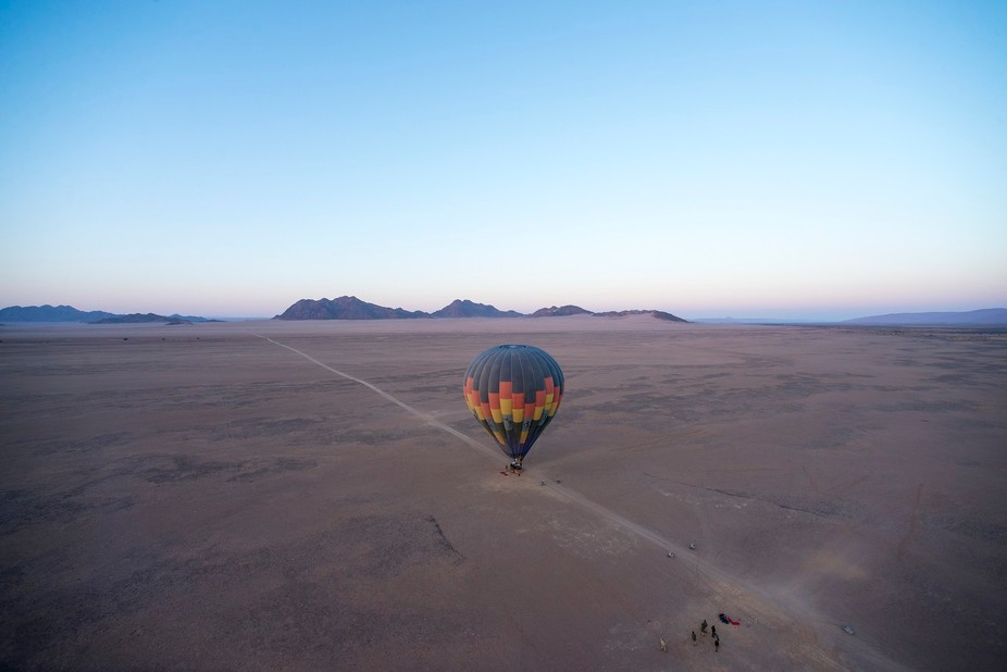 Two hot-air baloon leaving from the Namib desert, Namibia. We took off first, the second baloon a...
