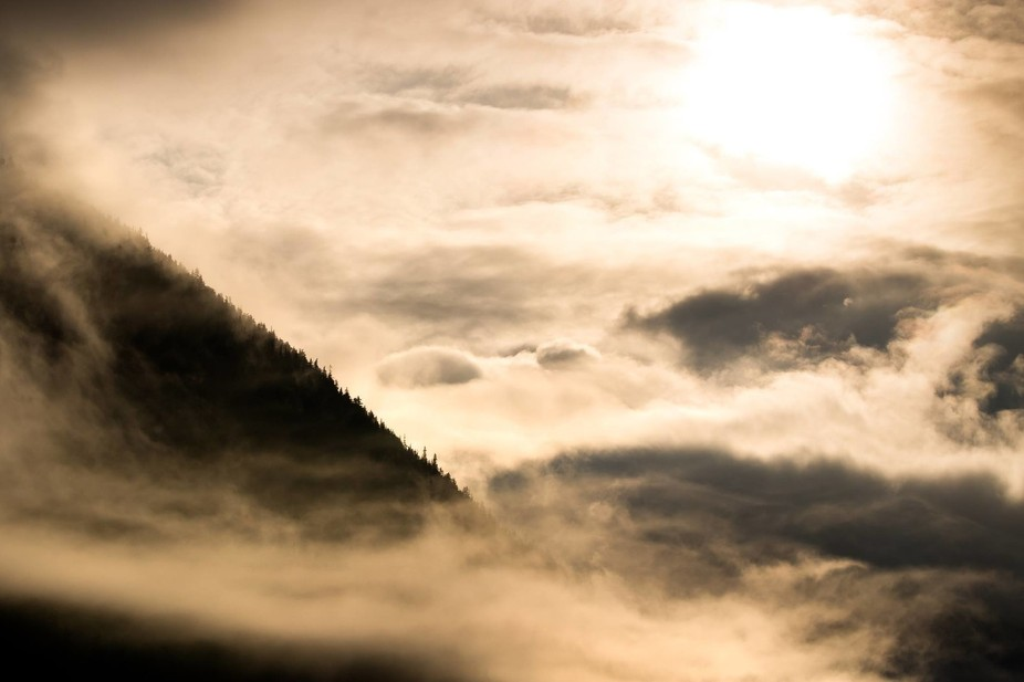 An intense scene developed as the sun rose over the mountains of southeast Alaska and lit the mis...