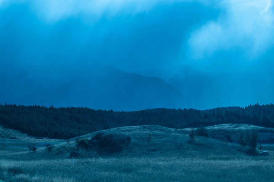 On our way to Twizel one evening, the skies became heavy and opened up with this steel blue downp...