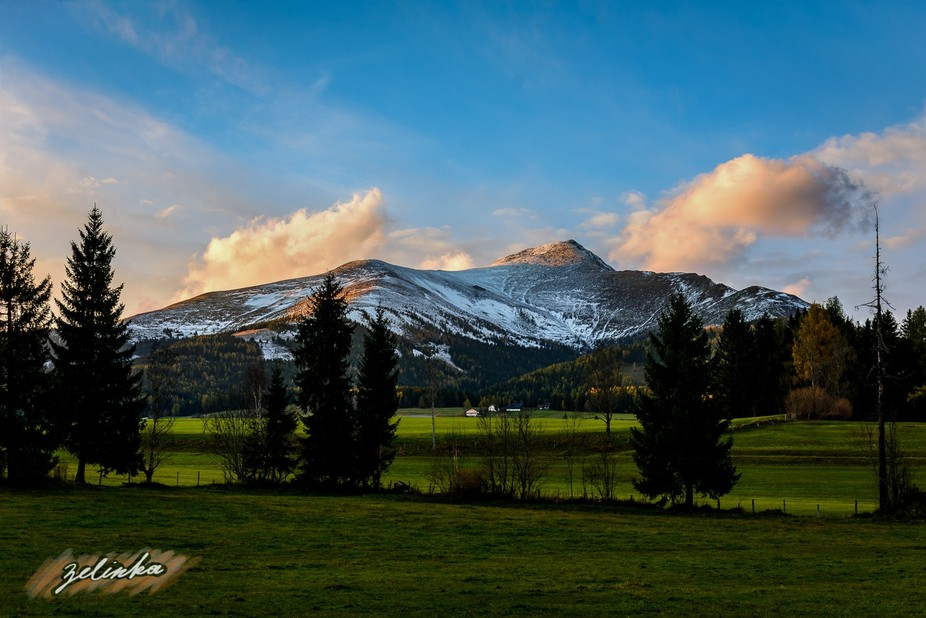 a sunset shot of the snow powdered mountain Greim in the Austrian Alps