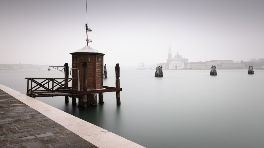 Long exposure shot taken from the Zattere Pier walkway in Venice, looking over to the island of S...