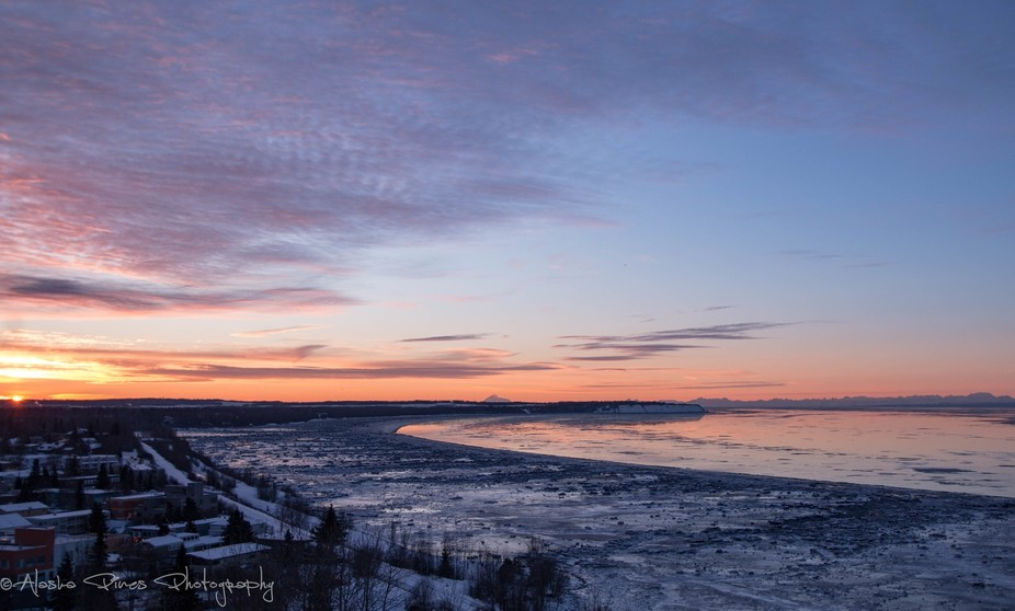 A beautiful sunset overlooking the Knik arm of Cook Inlet, from a rooftop in down-town Anchorage,...