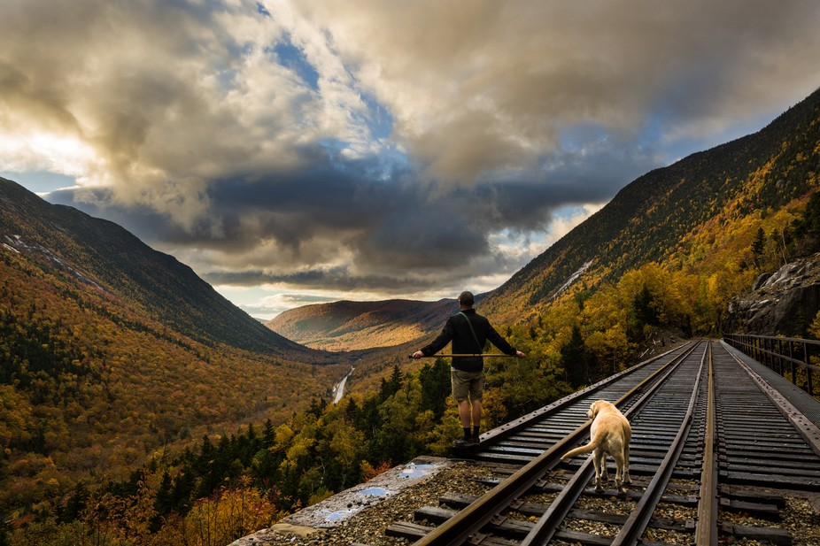 Chris and his dog Tazz looking at the sun peaking through Crawfords Notch.