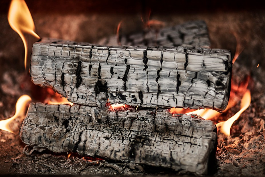 One of the four elements - Fire. Wood burning in a fireplace.