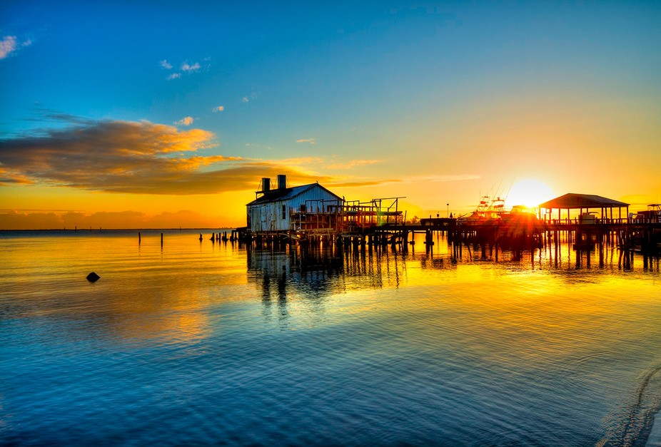 This is a sunrise over the Archie Smith fish house in Sebastian, Florida.
