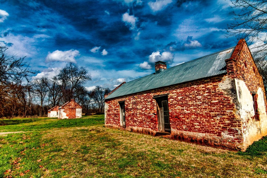 The slave quarters at Magnolia plantation are of brick construction, some are one room others are...