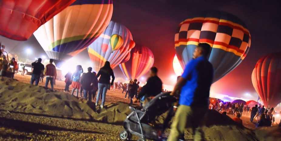 The rush was on to visit the many Balloons Glowing in the early evening sunset! Holiday Balloon G...