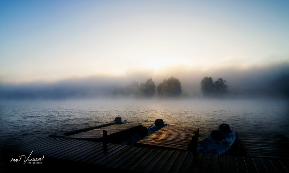 Taken early morning over Pine Lake in SA. Mist was moving in over the water and the sun almost sh...
