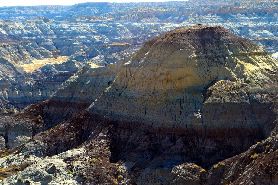 """The """"badlands"""" surrounding Angel Peak in northwestern New Mexico resemble a min..."""