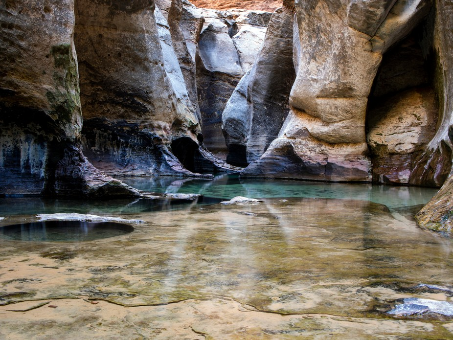 If you were to brave the cold, deep pools at the entrance of this slot canyon, you would be rewar...