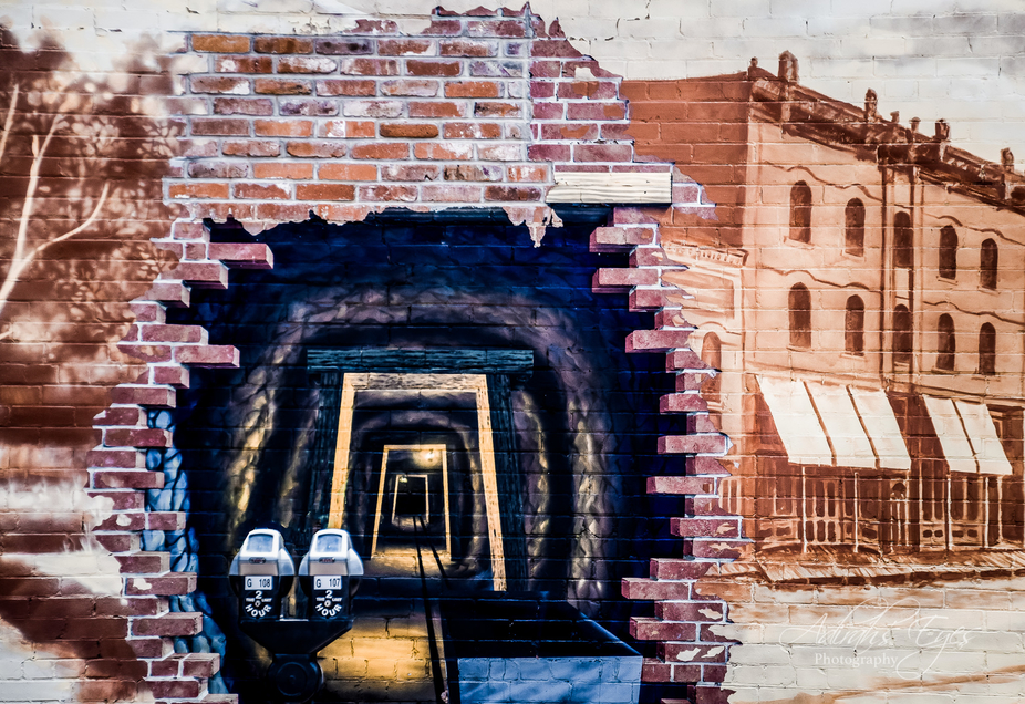 Love this wall art. It looks like a tunnel, gold mine, fascinating possibilities. The parking met...